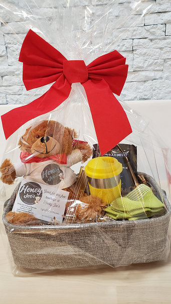 1 Teddy Bear with T-shirt & red bow<br>1 stainless steel kids tumbler cup<br>1 pack of 5 Honey Sticks<br>1 pair kids gripper socks<br>1 packet of hot cocoa mix<br><i>Please indicate child's age and top 3 favorite colors in the Notes section below.</i>