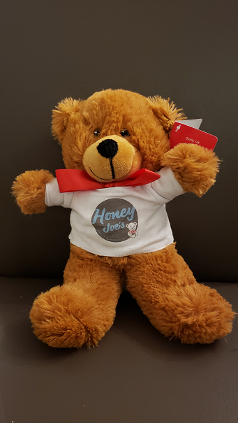 Teddy bear with T-shirt & red bow
